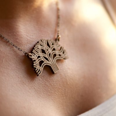 Lasercut Bamboo Oakland Pendant on Neck